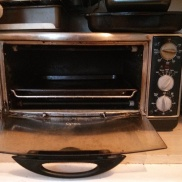 Open oven, with a baking pan inside.