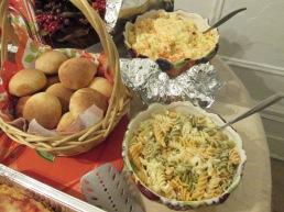 From left clockwise: rolls, potato salad, macaroni salad