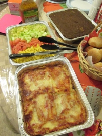 Eggplant casserole, tossed green salad, and pastelón