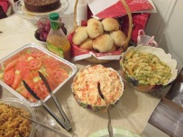 Clockwise from top: DInner rolls, Macaroni Salad, Potato Salad, Green Salad
