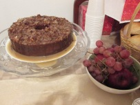 Bahamian Rum Cake and a bowl of grapes and apples